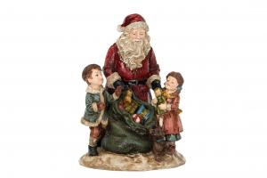 Jultomte som delar ut julklappar till barnen - 16,5 x 16 x 24 cm - www.frokenfraken.se
